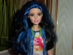 This sale is for an evolution hybrid barbie fashionista doll with beautiful two tone blue and black hair and flat feet. Her head is from the Candy Stripes Curvy Barbie. She also comes with a 2nd outfit (black crop tassel tank, side slit tribal print maxi skirt, and teal bangle) to change her look! | eBay!