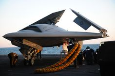 An X-47B Unmanned Combat Air System (UCAS) demonstrator is loaded onto an aircraft elevator aboard the aircraft carrier USS George H.W. Bush (CVN 77).