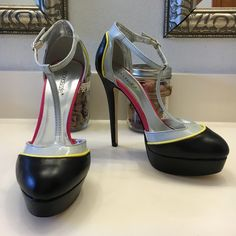 Shoe Dazzle Color Block T-Strap Pump Color Block pump by shoedazzle.   Grey T strap yellow pipe detail.   Black faux leather toe and heel.  Excellent used condition - never worn out. Shoe Dazzle Shoes Heels