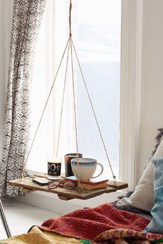 Why not hang shelves instead of a typical nightstand? Source: Urban Outiftters