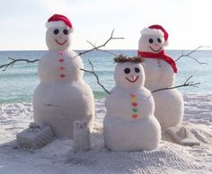 Sand snowmen:) Oh how I wish I were there.