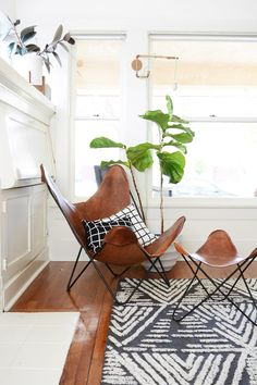West Elm - Mid-Century Living Room With Leather Butterfly Chair /