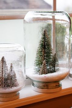 ^Waterless Snow Globes-Prime and spray paint the lids of each jar and let them dry (overnight is best). Next glitter the trees with white gold glitter, this is just a little added detail....this step is completely optional, it just added a little shine.  Hot glue the trees into the lid: Pour snowflakes into jar, screw on lid.