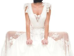 """Dimitris Katselis"" bridal collection is romantic with a feminine touch . White silk chiffon dress with lace details."