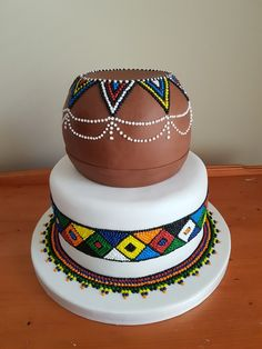 My version of the african wedding cake everyone enjoys copying in sa. The Effective Pictures We Offer You About traditional wedding cakes unique A quality picture can tell you many things. African Wedding Cakes, African Wedding Theme, African Wedding Attire, African Weddings, Nigerian Weddings, African Attire, Themed Wedding Cakes, Unique Wedding Cakes, Themed Cakes