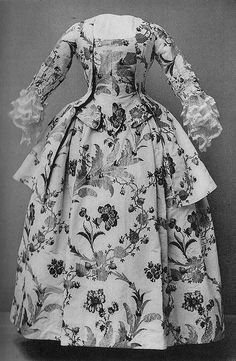 Outfit in thick gold and silver brocade with a multi-coloured floral pattern. Worn by an admiral's wife in the 1750's.    Nordiska Museet, Stockholm, Sweden