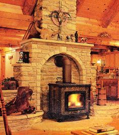 (THE wood stove from Northern Tools we will be using.and the stove surround JUST like this beautiful one in the faux stone.) me: omg-to die for. Wood Stove Surround, Wood Stove Hearth, Stove Fireplace, Wood Burner, Fireplace Wall, Fireplace Design, Fireplace Ideas, Dark Wood Kitchen Cabinets, Kitchen Wood
