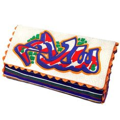 Salaam is the word for 'peace' in Arabic. Depicted in embroidery, this 'calligraffiti' piece was created exclusively for Ragmatazz by Frez - graf writer from the UK, who is renowned for writing fresh tags, leaving catchy throwies in the streets, hitting subways with crazy colorful panels and also mastered big colorful pieces.