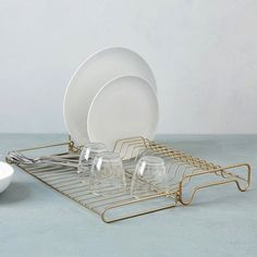 "Clean-lined kitchen. Tired of kitchen accessories that clutter? Our Wire Kitchen Collection keeps things neat with geometric angles and a deco finish. 18""w"