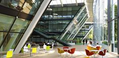 A sun-soaked gathering area is punctuated with colorful seating at the Astellas Pharma Europe headquarters in London by Perkins + Will, one of our Top 10 Interior Design Giants. See more work by. Top Interior Designers, Commercial Interior Design, Commercial Interiors, Futuristic Architecture, Interior Architecture, Best Interior, Modern Interior, Best Workplace, Office Space Design