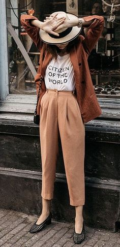 street style. tailored trousers. blazer. tee. hat.