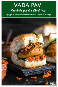 Vada Pav is Mumbais most popular street food! Spicy potato filling is sandwiched between burger buns and layered with a spicy garlic chutney! via Cook With Manali Japanese Street Food, Indian Street Food, Easy Delicious Dinner Recipes, Yummy Food, Vada Pav Recipe, Hot Sandwich Recipes, Vegetarian Snacks, Indian Food Recipes, Ethnic Recipes