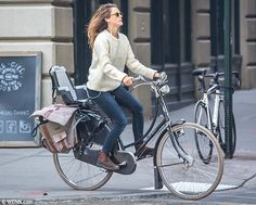 I don't personally approve of headphones while biking, but I like the rest of this! --> Keri Russell: The mother-of-two still had a child seat fastened to the back of her bike