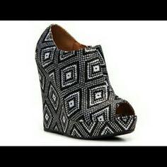 Tribal Print Enrich Wedge Bootie Enhance your outfit with with a  print in these wedge booties! It features peep toe front, colorful tribal print satin upper, covered platform and wedge heel. Finished with padded insole for your comfort. Side zipper closure for easy on/off. Worn once. Qupid Shoes Wedges