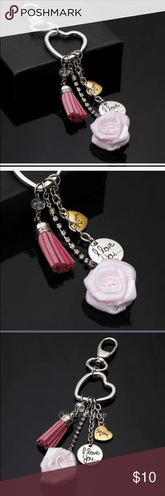 """Mom... I Love You keychain New retail.  Silvertone circle reads """"I love you..."""" , Goldtone heart reads """"mom"""". pink leather tassel. Bling chain drops with a pink fabric rose at the end. Can use as a key chain or hang in rear mirror or clasp to purse as decor. Super pretty. 6"""" long. A great way to remember your mom if she's passed away or a sweet way to honor her with a special gift. Cute as a gift topper as well to decorate a larger gift. Accessories Key & Card Holders"""