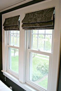 Reed attached the roman blinds Shelley made to existing mini-blind hardware.
