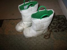 Rain boots wrapped with gauze and packing tape make astronaut boots!