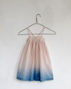 Wolfechild hand dyed cotton spaghetti strap dress with criss crossing straps. Elastic gathering at back.