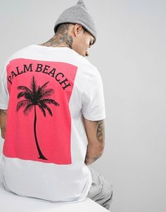 ASOS - T-shirt long avec imprimé palmiers au dos - Rose