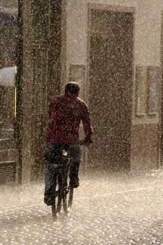 Pedddling in the rain. Stop The Rain, I Love Rain, Singing In The Rain, Its Raining Its Pouring, Black Forest Germany, Smell Of Rain, Rain Go Away, Rain Storm, Going To Rain