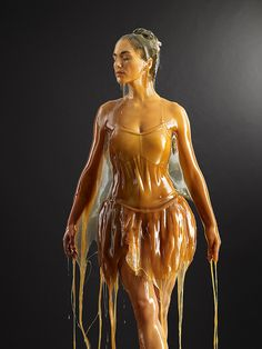 "Blake Little's viscous-looking series ""Preservation"" features models encased in gallons of honey."