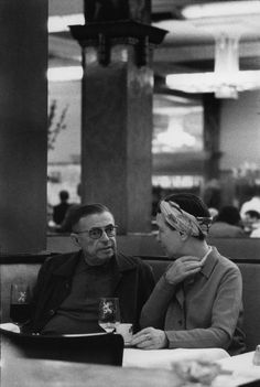 Bruno Barbey FRANCE. Paris. 1969. Jean-Paul SARTRE and Simone de BEAUVOIR at La Coupole brasserie.