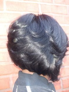 side of razor cut bob hair style......