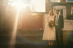 Urban Bride & Groom Portrait with Sunsetting - Image by Babb Photo - A London Autumnal wedding at the Londesborough pub in Stoke Newington with a bespoke wedding dress and photography by Babb Photo.