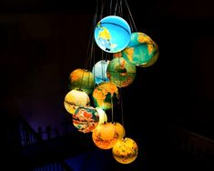 """While this may not necessarily be a """"Kid Friendly Craft,"""" it is a craft idea that kids will adore and can help create!  Gather old globes from flea markets and yard sales, and then fit the globes with cord sets (found at nearly any hobby store). It will be a fun project, and you'll have a unique and lovely light fixture when you're finished!"""