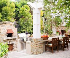 Such an awesome patio. I want a backyard big enough to have a builtin grill tables and plenty of room for my kids to play