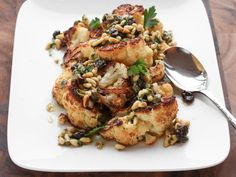 Roasting cauliflower in fat wedges, at very high heat, creates a nice contrast between deeply browned exterior and tender, meaty interior. It's great on its own, but we love using it to make a warm salad with a more elaborate vinaigrette, like this one flavored with pine nuts, capers, and raisins.