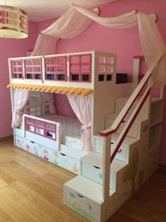 Beautiful bunk bed, stairs with storage drawers and pink feature wall. Beds & cribs by OFR UNIPESSOAL LDA