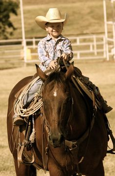 Cute little cowboy ...riding at a pretty young age ... <3 it!