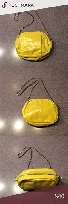 "Walter Baker Lemon Yellow Crossbody Handbag Walter Baker Lemon Yellow Crossbody Handbag. Silver Tone hardware. Chain has 22"" drop. Inside zipper pocket and inside open pocket for phone. Perfect size for phone, wallet and keys. Pristine used condition. Feels like leather although not marked. Great condition. A few tiny scuffs as pictured. You will love this! ❤️ Walter Baker Bags Crossbody Bags"