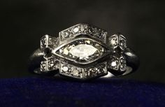 antique engagement rings for vintage brides 1920s art deco marquise. Looks like an eye.  Surrounding diamons = turquoise this would be my dream.