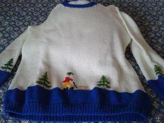 suéter navidad. Tejido a dos agujas y bordado. Detalle en cuerpo y mangas