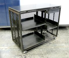 Custom retail cart in blackened steel and expanded sheet metal by Face Design + Fabrication