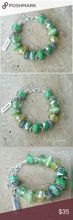 """Dream, candy apple green charm bracelet Premium quality glass, crystal spacers and unique marbled glass accents with one """"Dream"""" charm.  Placed on a silver plated adjustable snake chain, can be moved to another bracelet option if requested. Designed and created by hand, not mass produced, which means each piece is thoughtfully hand selected. Makes a special gift for yourself or someone else. Custom orders welcome. Discounts given on bundles. Salty Grace  Jewelry Bracelets"""