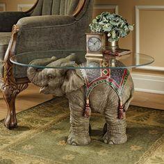 Baby elephant side table for an ethnic living room #sidetabledesign modern design #creativefurniture living room design #animalsidetable modern living room. Find more inspirations at our blog www.coffeeandsidetables.com