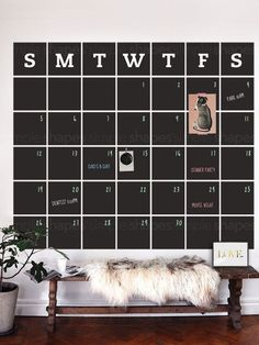 [Item #4036] Stay organized with the help of our extra large chalkboard wall calendar. This calendar wall decal incorporates a black chalkboard vinyl that you can write on and erase. It is applied directly to the wall. (Chalk Ink Pen not included.) No more dirty hands, try our Chalk