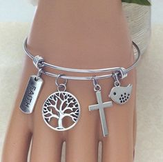 A personal favorite from my Etsy shop https://www.etsy.com/listing/521146200/christian-charm-bracelet-tree-of-life