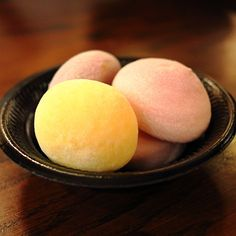 Mochi Ice Cream - Mochi is a Japanese rice cake made of glutinous rice that's pounded into a gummy paste and molded into different shapes. They come in sweet and savory varieties, and can be dyed any color. While eaten all year round, mochi is a traditional food for the Japanese New Year and is commonly sold and eaten during that time.