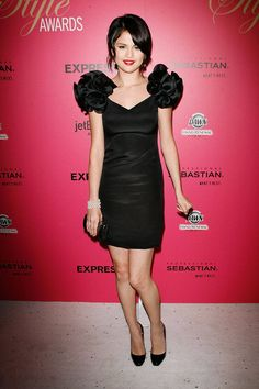 The actress wears a puffed-sleeve Notte by Marchesa LBD to the 6th Annual Hollywood Style Awards.    - ELLE.com