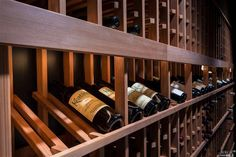 Custom wine cellar. I wouldn't leave this room. Might have purple teeth for life ;)