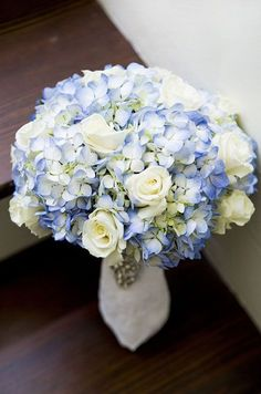 Blue hydrangeas add a pop of color to this bouquet. #weddingbouquet