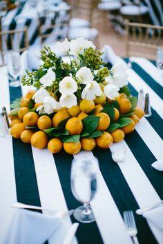 citrus and flowers wedding centerpiece / http://www.himisspuff.com/citrus-wedding-decor-ideas/