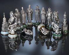 """Chess Set """"The March on Constantinople"""" :: An idea for this artistic development was a historical event - a war between Ukraine and the Ottoman Empire. All figures made of silver. The ornamental Florentine mosaic made of tiger eye and hawk eye stones were used to form the figure bases along with white and green jade."""