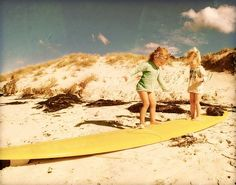 Me and my sister as little girls learning to surf