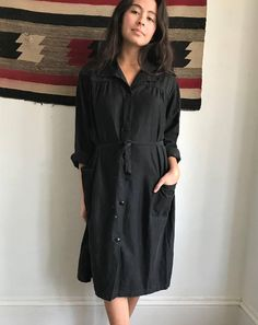 Excellent vintage condition!!! - beautiful black simple work dress - cotton - buttons up the front and has waist tie - some small paint stains and wear, see photos - missing middle button under belt at waist - sun faded - little rick rack trim - versatile with size Measurements: -bust