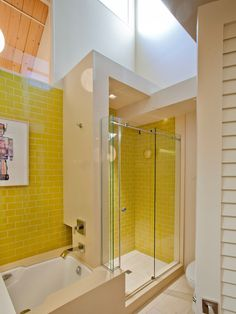 Gorgeous modern shower/bath wall with Yellow Subway Tiles. https://www.subwaytileoutlet.com/products/Yellow-Glass-Subway-Tile.html#.VnCIgriDFBc